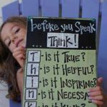 Girl holding a board with the word think on it