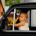 toddlerbehindwheelofcar