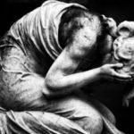grieving woman kneeling on floor